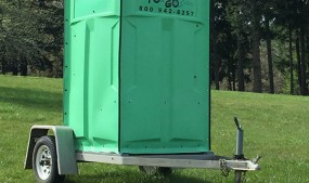 """Green unit """"To Go"""" on a trailer"""
